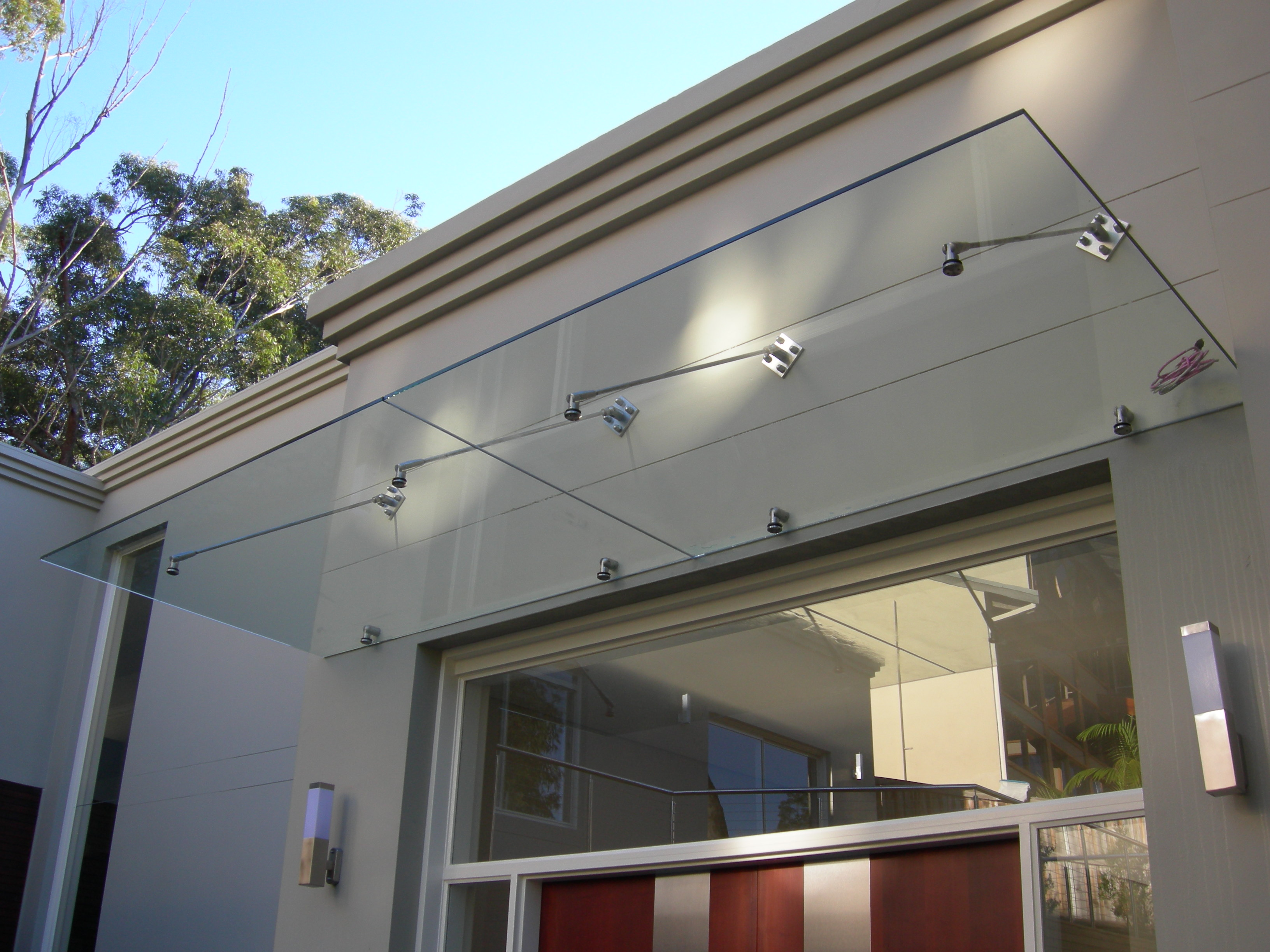 Residential Door Canopy. Toughened laminated clear glass & Trinity Steel Canopies - Trinity Steel